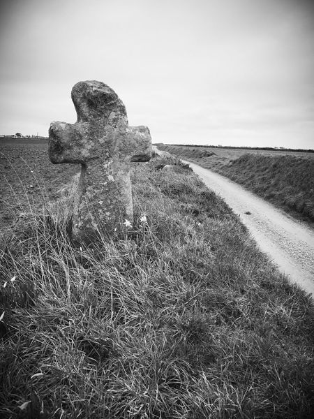 Calvary Blackandwhite Tranquility Sky Outdoors Tranquil Scene Graveyard Cross No People Day Religion Nature Plouguerneau France Brittany Lost In The Landscape
