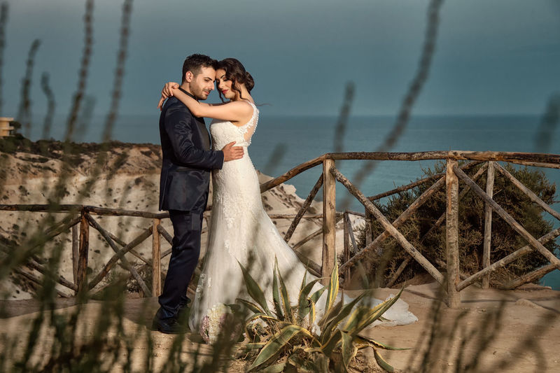Adult Bonding Connection Couple - Relationship Emotion Love Men Nature Outdoors People Plant Positive Emotion Real People Standing Togetherness Two People Wedding Dress Women Young Adult Young Men Young Women