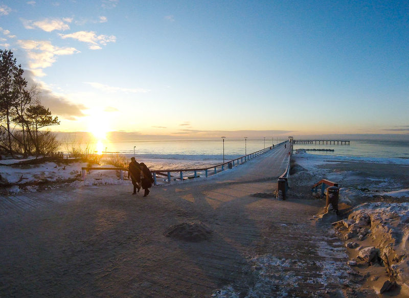 Frozen beach on Baltic Sea, Palanga, Lithuania Baltic Sea Baltic Sea Winter Frozen Frozen Beach Holiday Ice Icy Water Lithuania Travel Beauty In Nature Bridge - Man Made Structure Cold Temperature Day Icy Nature Outdoors Palanga Scenics Sea Sky Snow Sunset Tranquility Winter