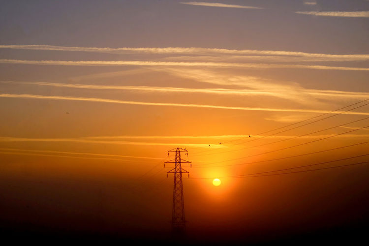 National Grid Pylons And Power Lines Sunrise Silhouette Beauty In Nature Cable Cloud - Sky Connection Electrical Equipment Electricity  Electricity Pylon Fuel And Power Generation Low Angle View Misty Morning Nature Orange Color Outdoors Power Line  Power Supply Romantic Sky Scenics - Nature Silhouette Sky Sun Sunset Technology