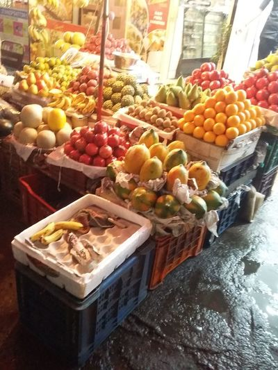 Road side fruit vendor Road Side Fruit Stall Market Stall Fruits Papaya Banans Price Tag Market Choice Variation Retail  Grape Apricot Market Stall For Sale