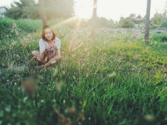 Lens Flare Grass Sunlight Meadow Young Women Young Adult One Person Simple Living Enjoyment One Young Woman Only Beauty People Nature Sun Outdoors Summer Tree Women Adults Only Real People The City Light EyeEmNewHere