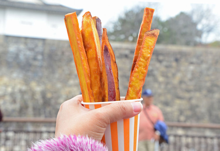Fried Sweet Potatoe Potato Snack Close-up Day Focus On Foreground Food Food And Drink Freshness Fried Fried Potato Fried Potatoes Holding Human Body Part Human Finger Human Hand Leisure Activity Outdoors Potatoes Ready-to-eat Sweet Yellow