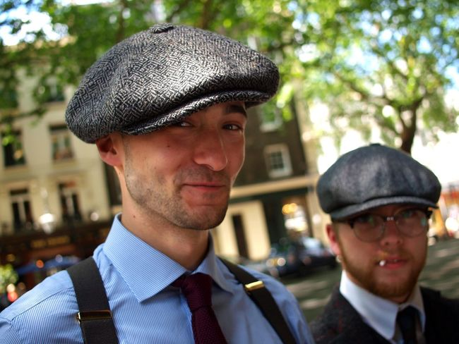 1930's in 2018. Central London. 02/06/2018 Cloth Caps Hats Portrait Retro Styled Retro 1930 Fashion Peaky Blinders Fashionable Smart London News Stevesevilempire Steve Merrick Olympus Zuiko Headshot Portrait Men Males  Adult Cap Clothing Mid Adult Men People Two People Young Men Lifestyles Looking At Camera Menswear