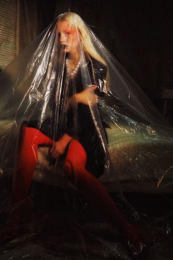 Woman looking at illuminated camera