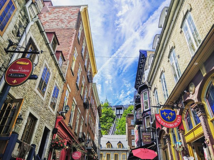 Building Exterior Architecture Built Structure Sky Low Angle View Outdoors City Day Text No People Skyscraper Québec Canada Quebec, Canada Quebec City Quebec Sculpture Cloud - Sky Low Angle View