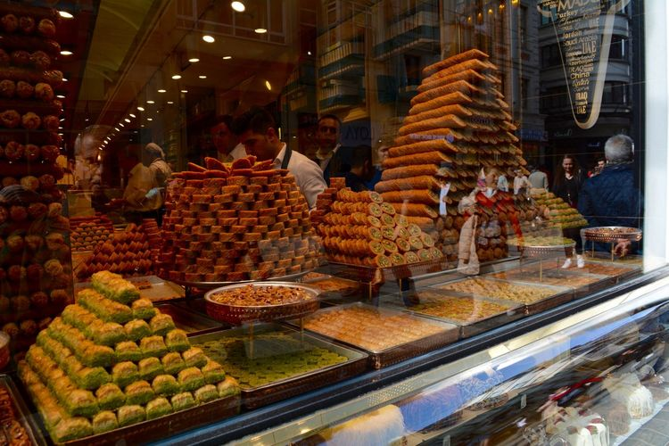 Abundance Architecture Baklava Business Choice Dessert Shop Food Food And Drink For Sale Freshness Group Of People Healthy Eating Illuminated Incidental People Kadayif Market Market Stall Men Night Real People Retail  Shop Window Transparent Turkish Dessert Variation