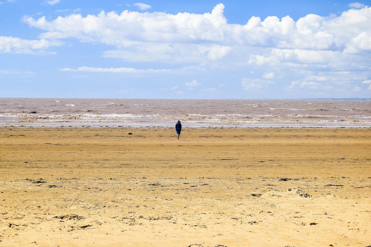Sky Land Sea Beach Nature Water Beauty In Nature Scenics - Nature Sand Outdoors Beach Photography Horizon Over Water Landscape Beachscape Leading Lines Blue Sky Cloud - Sky Horizon Tranquility Tranquil Scene Day One Person Non-urban Scene Real People