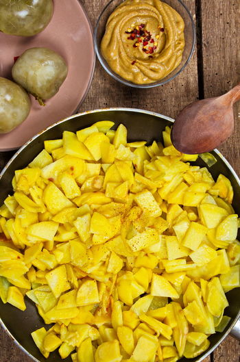 High Angle View Of Yellow Vegetables In Pan