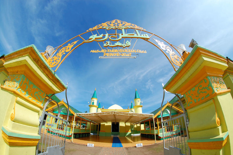 Sultan Mosque at penyengat island Riauisland Architecture Building Exterior Built Structure Cloud - Sky Day Low Angle View Masjid Mosque No People Outdoors Place Of Worship Religion River Sky Spirituality Yellow First Eyeem Photo