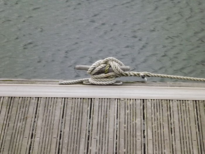 mooring knot isolated with pier and water background Nautical Equipment Animal Themes Day Knots Nautical No People Pier Rope Rope Knot Sailing Water Wood - Material