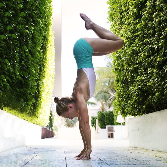 Handstand  Yogogirls Yoga Pose Yoga Hotel Trees And Bushes