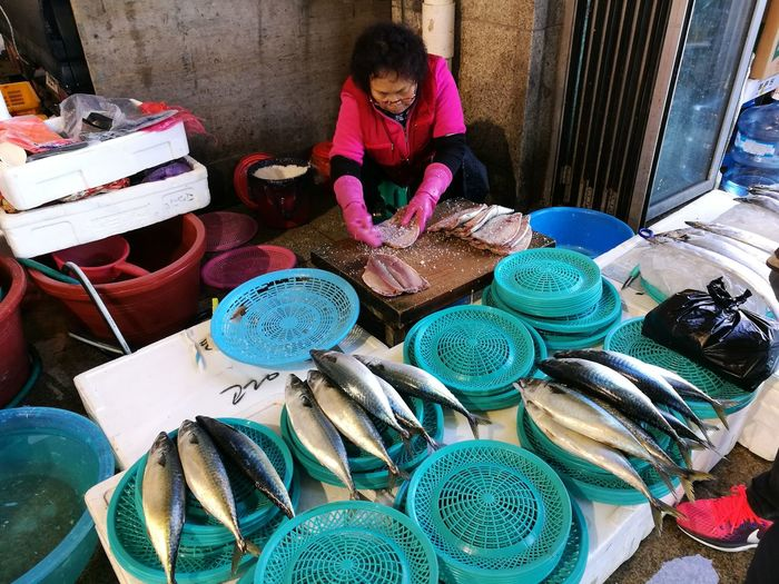Salting fishes Wet Market Pohang Jukdo Market Hard Work Occupation One Woman Only Working Hard Gutting Fish Cleaning Fish Fish Market International Women's Day 2019 Multi Colored Choice Retail  Variation Women Store High Angle View For Sale Market Stall Fish Market Stall Market