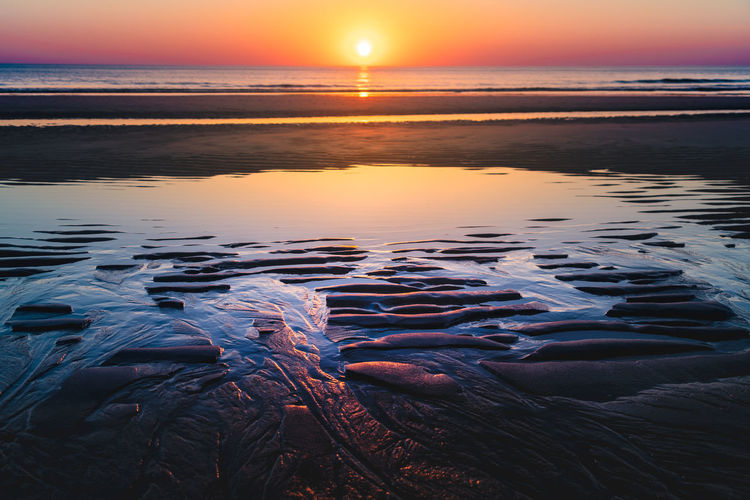 Sylt, Germany Beach Beauty In Nature Horizon Horizon Over Water Idyllic Land Nature No People Non-urban Scene Orange Color Outdoors Reflection Scenics - Nature Sea Sky Sun Sunset Surface Level Sylt Tranquil Scene Tranquility Water