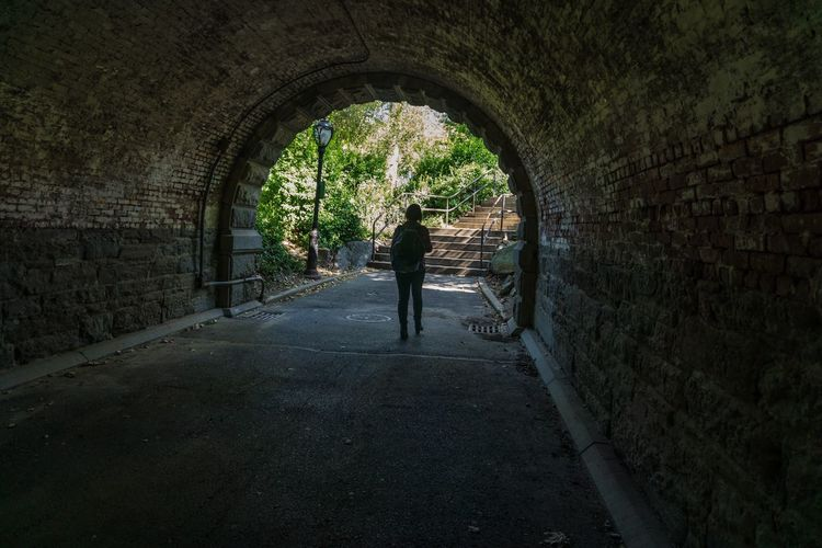 Arch Architecture Wall - Building Feature The Way Forward Built Structure Tunnel Old Archway Wall Rear View Weathered Pedestrian Walkway Building Exterior Diminishing Perspective Footpath Stone Wall Surrounding Wall Day Walkway History Woman