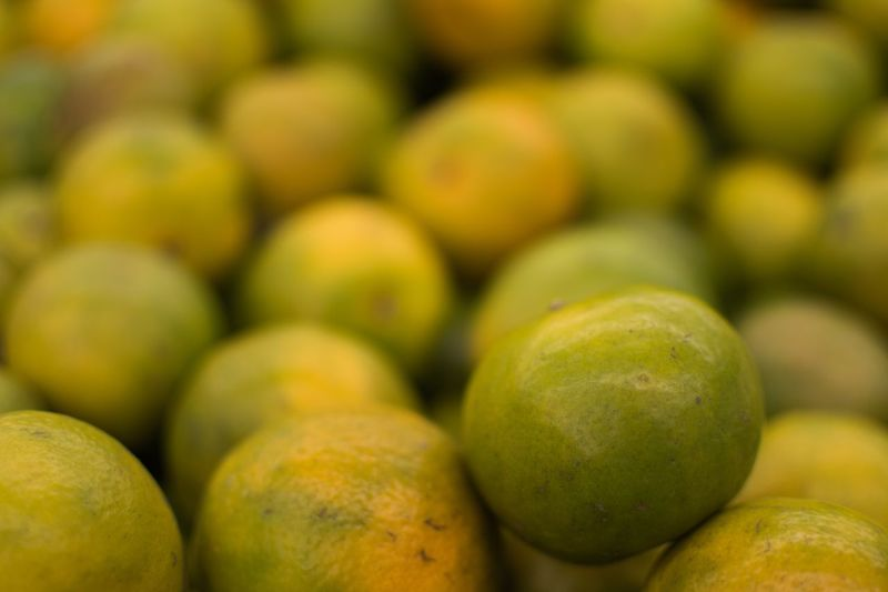 Orange Food And Drink Healthy Eating Food Fruit Wellbeing Freshness Market Abundance Large Group Of Objects Retail  Close-up Green Color Yellow Focus On Foreground Market Stall Full Frame No People Backgrounds Ripe Still Life