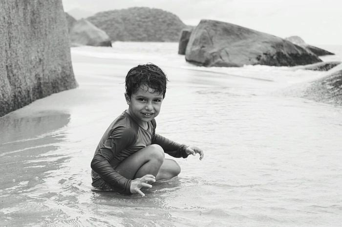 Child Portrait Water Childhood Looking At Camera Children Only Outdoors Emotion Relaxation Summer Beauty Lifestyles Happiness One Boy Only Sand Beach Playing People Cheerful Tropical Climate Nature Trindade-RJ Tranquility Travel Destinations Horizon Over Water