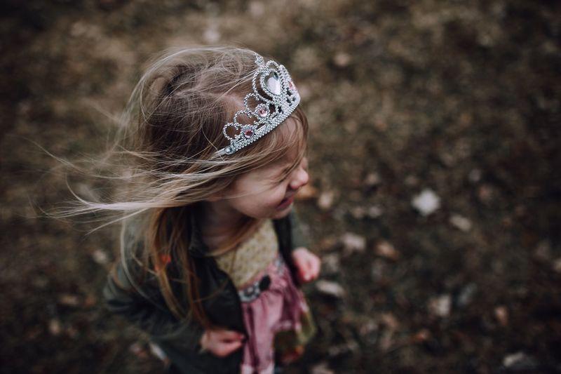Girl wearing tiara while standing on land