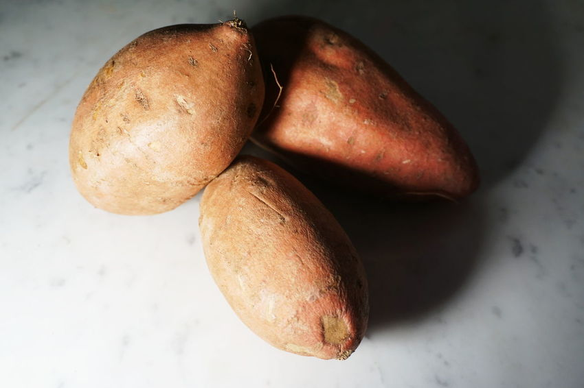 Isolated sweet potatoes on white marble background Food And Drink Potato Raw Vegetarian Vegetarian Food Carbohydrates Carbs Close Up Fitness Food Healthy Healthy Eating Healthy Food Healthy Lifestyle No People Organic Organic Food Potatoes Raw Food Still Life Studio Shot Sweet Potato Vegan Vegetable White Background