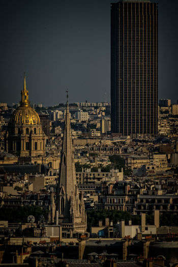 Hotel Des Invalides With Cityscape Against Sky