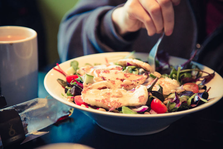 A bowl of halloumi salad. Fork Salad Bowl Bowl Of Food Cafe Drink Food Food And Drink Freshness Halloumi Halloumi Salad Healthy Eating Human Hand Indoors  Plate Ready-to-eat Restaurant Serving Size Table