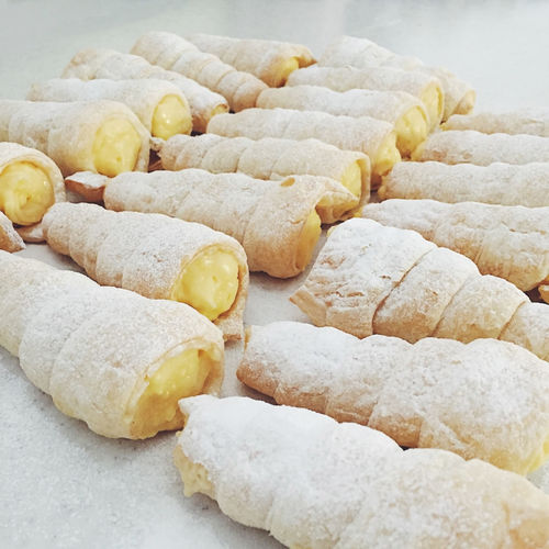 Puff pastry rolls filled with cream Austrian Bakery Close-up Cream Creamy Delicious Dessert Filled Food Freshness German Gourmet Pastry Puff Roll Row Schaumrollen Sugar Sweet Tasty Traditional Whipped