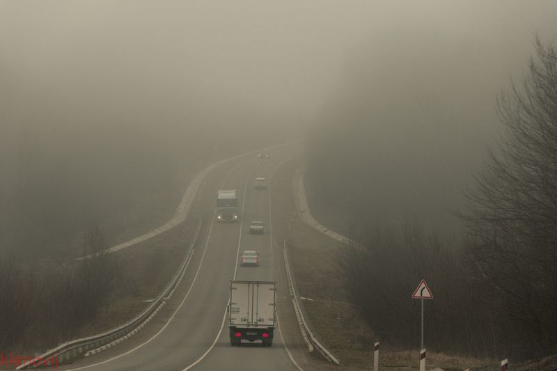 Vehicles On Road During Foggy Weather