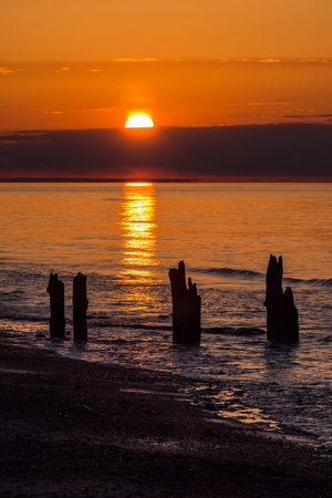 Evening on shore of the Baltic Sea. Baltic Sea Kuehlungborn Relaxing Romantic Beach Beauty In Nature Coast Groynes Horizon Over Water Idyllic Scenery Kühlungsborn Nature No People Outdoors Scenics Sea Shore Sky Sundown Sunset Tourism Travel Destinations Vacation Water Waves