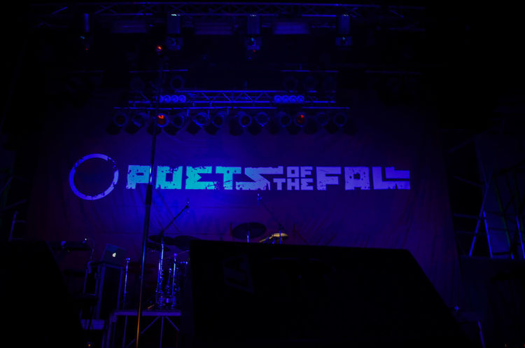 Poets Of The Fall Text Arts Culture And Entertainment Communication Night Illuminated Music Western Script Blue Neon Technology Indoors  Nightlife Dark Performance Lighting Equipment Stage No People Sign Stage - Performance Space Information Light Concert Music Festival Purple
