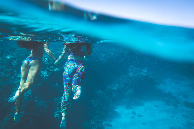 Water Sea Underwater Swimming Lifestyles Leisure Activity Nature Two People UnderSea Swimwear People Togetherness Clothing Blue Day Sport Adult Real People Women Outdoors Swimming Pool Human Arm