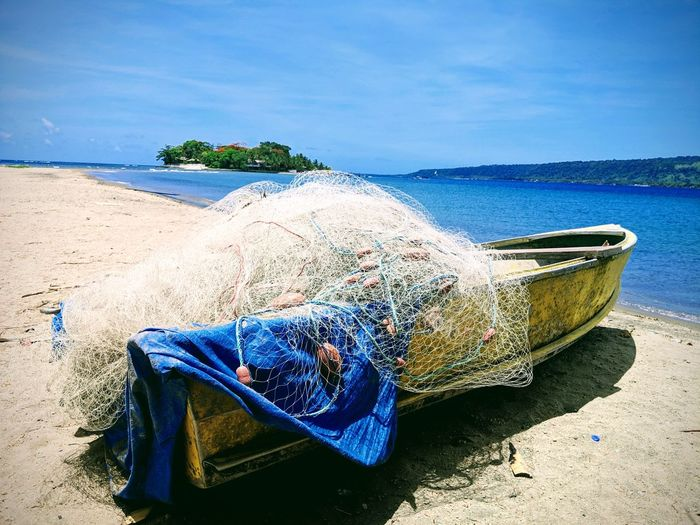 Boat Fishing Fishing Net Water Sea Beach Sand Blue Summer Relaxation Sky Shore Sandy Beach Ocean Seascape Coast Calm