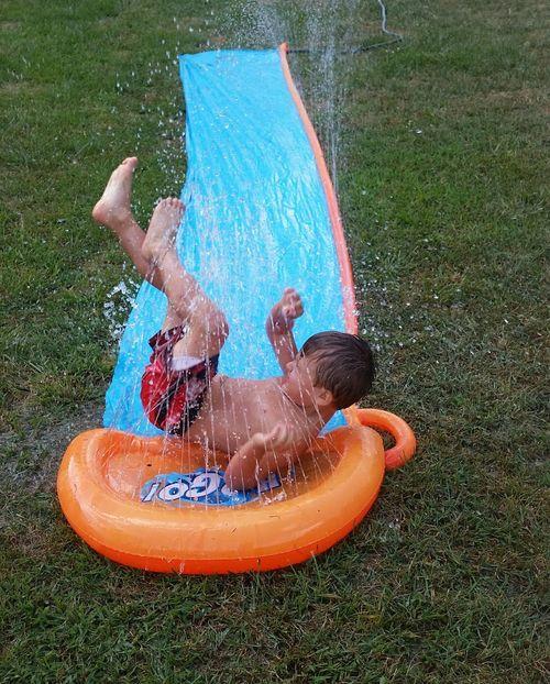 Wet Fun💕 Missouri Ozarks, USA 💥💖 Summer Time  Family 🙏🙌 Preschooler 👫 Grandkids 💙💛💜 Water Child Childhood Water Slide Spraying Full Length Boys Friendship Playing Males  Slide - Play Equipment Outdoor Play Equipment Inflatable