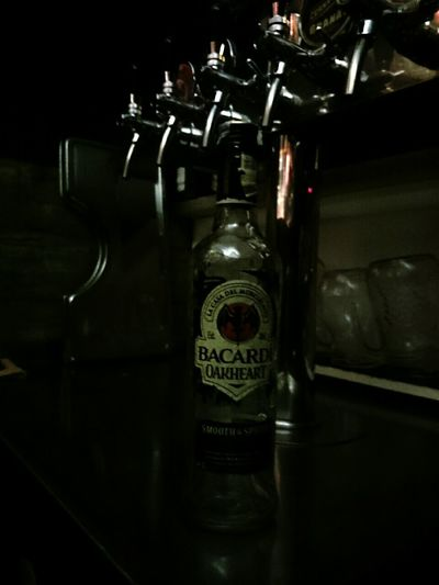 Bottle of Bacardi  Oakheart next to Tap it was Birthday Present )