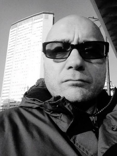 Sunglasses Headshot One Person Looking At Camera Portrait Lifestyles Real People Young Adult Adults Only Only Men Indoors  Night Close-up People One Man Only Arrest Adult