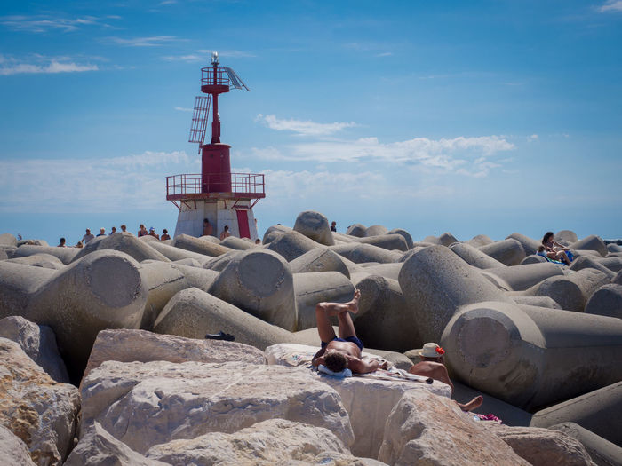 Sky Solid Rock Nature Rock - Object Sea Cloud - Sky Built Structure Beach Water Protection Land Architecture Guidance Safety Tower Security Day Lighthouse Outdoors