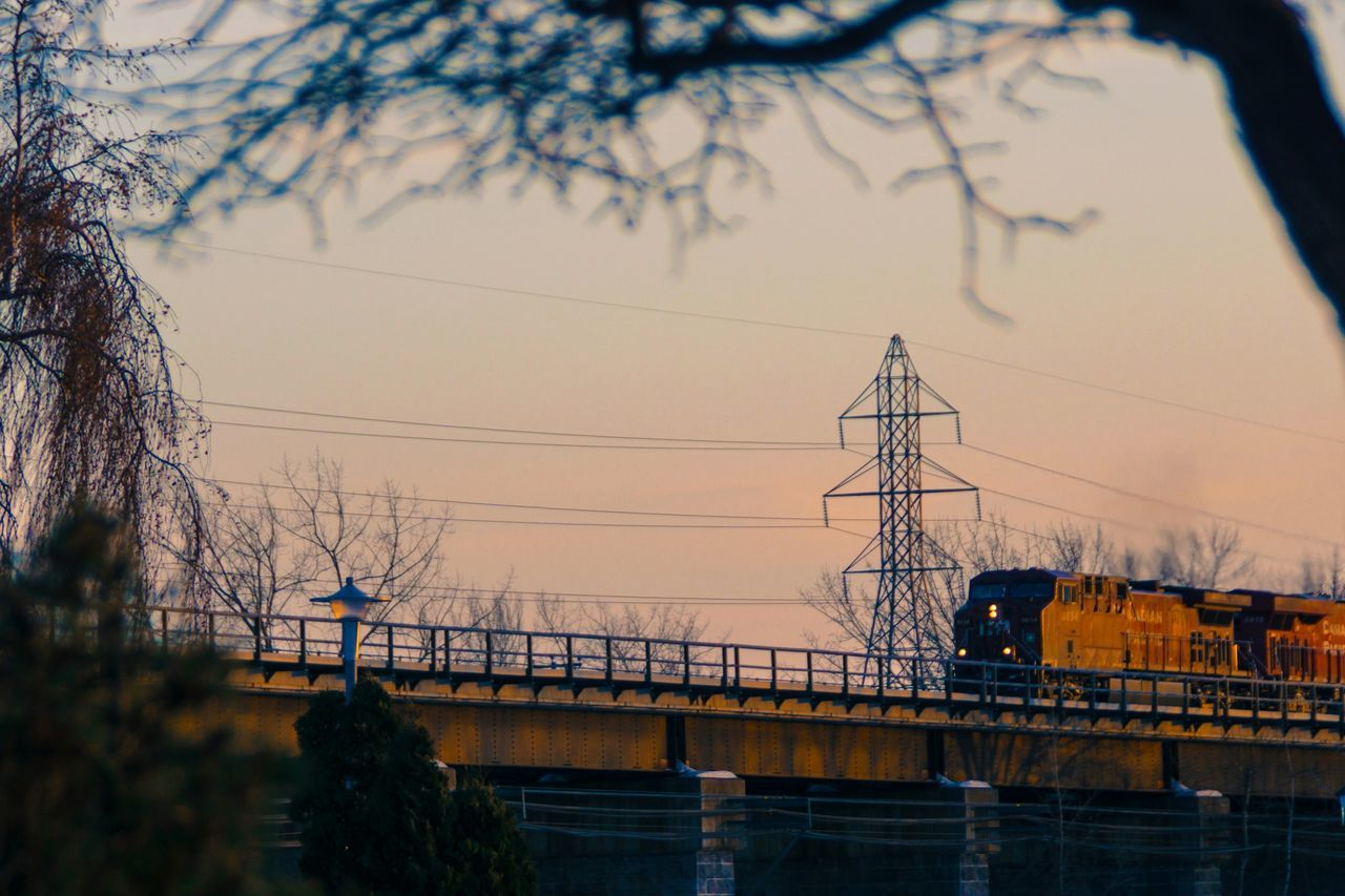 connection, cable, sunset, tree, electricity pylon, power line, no people, nature, electricity, power supply, outdoors, silhouette, sky, built structure, water, beauty in nature, architecture, day