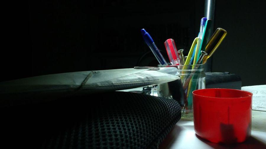 Pens In Desk Organizer By Folder On Table In Office
