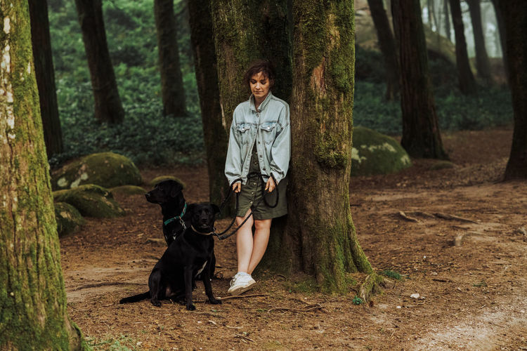 Portrait of woman with dog in the forest