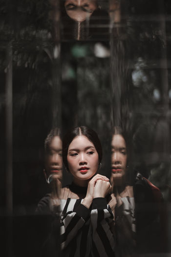 Reflection of beautiful young woman
