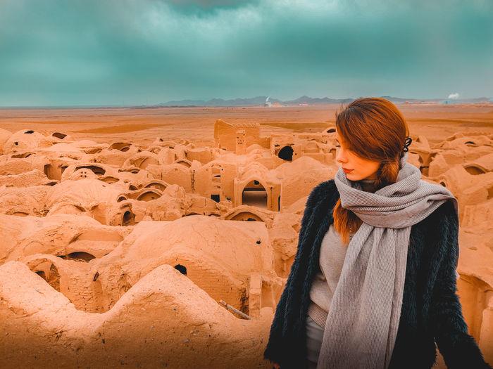 Full length of woman standing on land against sky