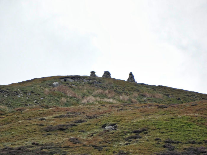 3 cairns on a hilltop. Sky Environment Landscape Nature Grass Land No People Hill Day Cloud - Sky Plant Scenics - Nature Tranquility Tranquil Scene Field Outdoors Beauty In Nature Rock Activity Mountain Peak Cairn Cairns Hills