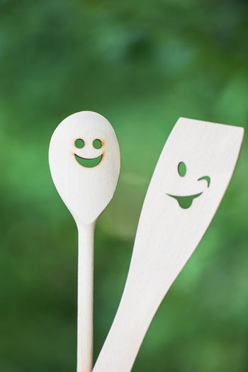 Close-up of anthropomorphic faces on kitchen utensils