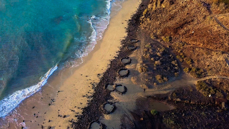 Photos taken at Fuerteventura at Cannary Islands mostly from drone at the beaches during sunrises and sunsets. Fuerteventura SPAIN Canary Islands Island Island Life Vacations Drone  Dronephotography Ocean Ocean View Sea Wave Artistic Exotic Rocks Mountain Cloud - Sky Sky Sunset Sunrise Epic Coastline Beach Water Outdoors