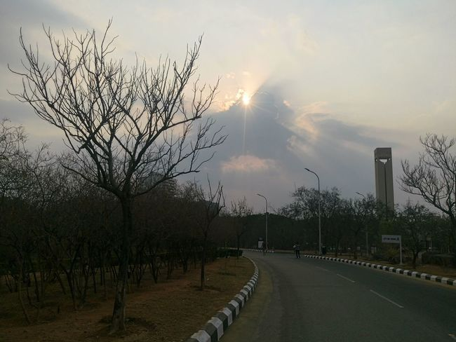 Peaceful Way to Walk Bare Tree Beauty In Nature Cloud - Sky Curved Road Day Man Made Tower Nature No Leaves Tree No People Outdoors Pre Sunset Sky Summer Effect Sun Sunrays_penetrating_clouds Tree Xperian Photography