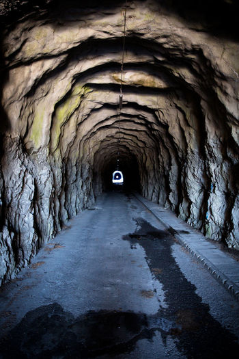 Direction The Way Forward Tunnel No People Arch Cave Diminishing Perspective Day Built Structure Road Solid Transportation Indoors  Rock Light At The End Of The Tunnel Nature Rock Formation Empty Way To Go Home Death Way darkness and light Tunnel View