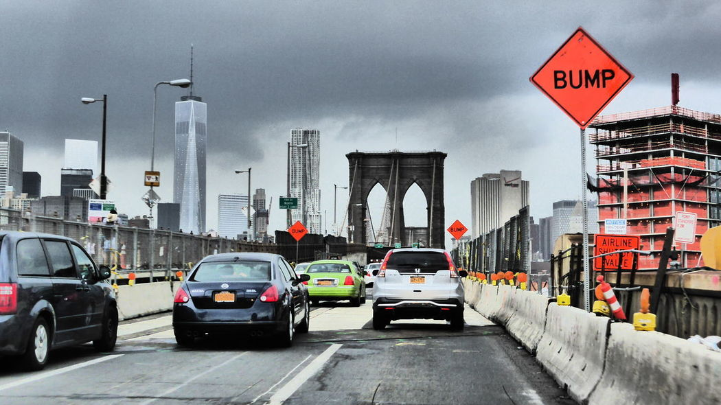 Baustelle Brooklyn Bridge / New York NYC Street Purplesnail Architecture Bad Street Building Exterior Built Structure Car City Cityscape Communication Day Land Vehicle Mode Of Transport No People Outdoors Road Road Sign Sky Skyscraper Street Street Light Transportation Travel Destinations