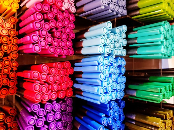 Full frame shot of colorful pens on shelf for sale in store