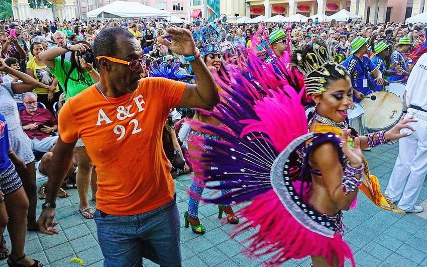 Andressa Lamba, the first Drum Corps Queen in Florida (Rainha da Bateria da Florida) dances with a fan in Mizner Park Amphitheater to start Brazilian Beat 2016 in Boca Raton Saturday, September 10, 2016. Brazil Braziliangirl Festival Samba Brasil