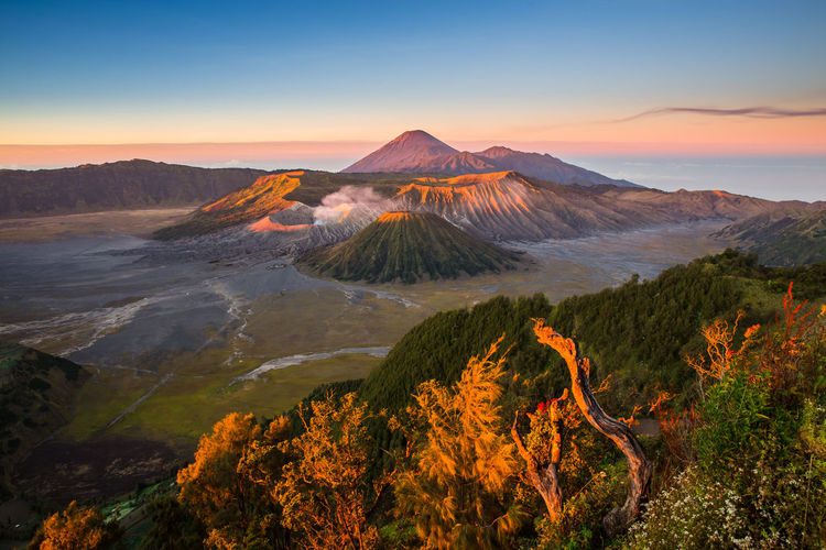 INDONESIA Beauty In Nature Bromo Environment Geology Idyllic Land Landscape Mountain Mountain Peak Mountain Range Nature No People Non-urban Scene Outdoors Physical Geography Scenics - Nature Sky Sunrise Sunset Tranquil Scene Tranquility Travel Destinations Volcanic Crater Volcano