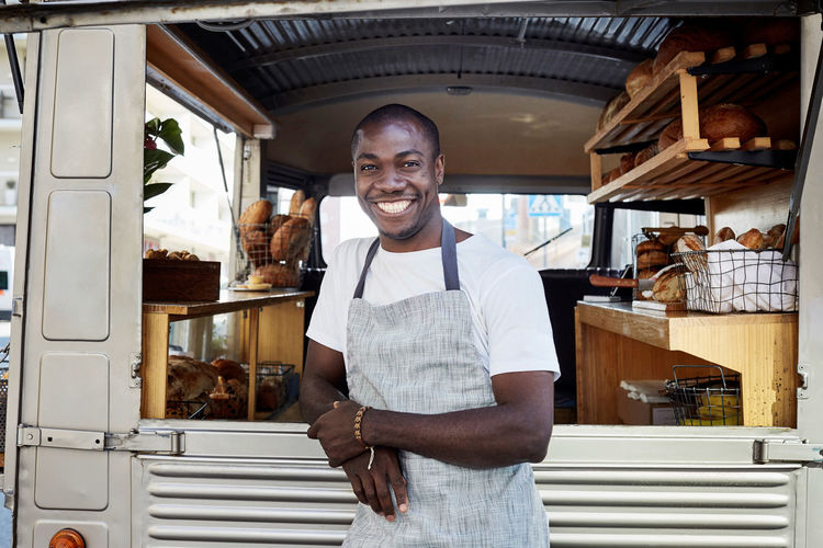 Portrait of smiling young man standing in store